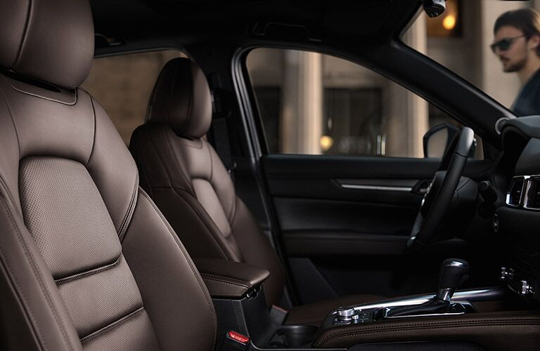Interior view of the front seating area inside a 2020 Mazda CX-5