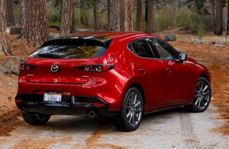 Exterior view of the rear of a red 2020 Mazda3 Hatchback