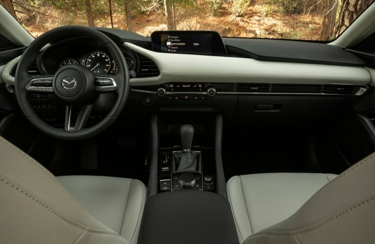 Interior view of the front seating area inside a 2020 Mazda3 Sedan