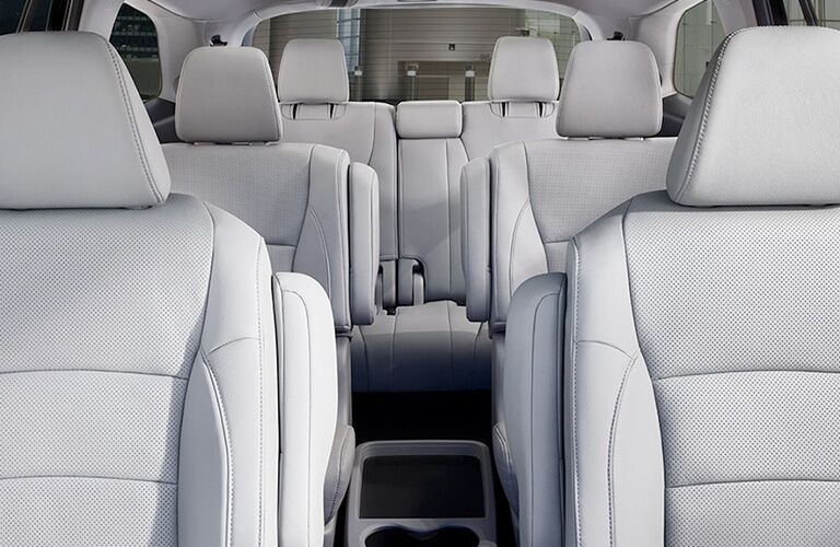 View looking back at the three rows of seating inside a 2020 Honda Pilot, with second-row Captain's Chairs in place.