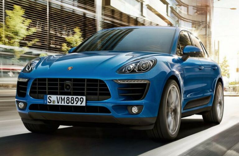 2018 Porsche Macan driving on road.
