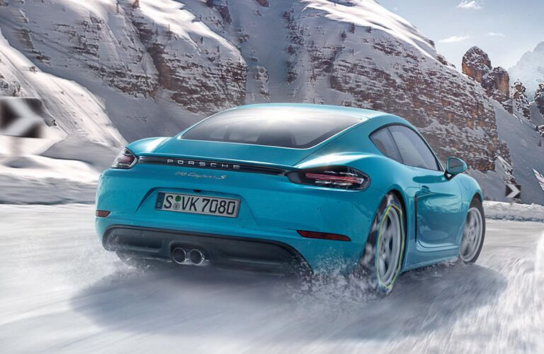 2019 Porsche 718 Cayman exterior back fascia and passenger side in snow