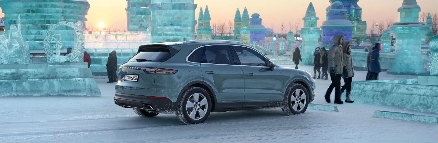 gray 2019 Porsche Cayenne parked at winter ice sculpture park