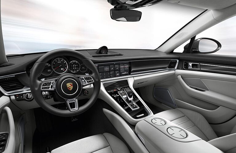 2019 Porsche Panamera interior front cabin steering wheel and dashboard with blank background in window