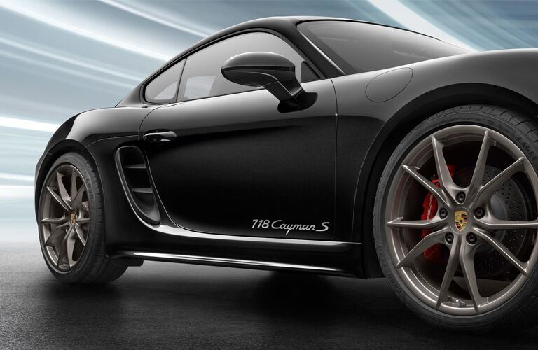 Close up of the passenger side exterior of a black 2019 Porsche 718 Cayman S