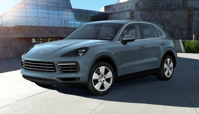 2019 Porsche Cayenne exterior front fascia and drivers side in front of glass building