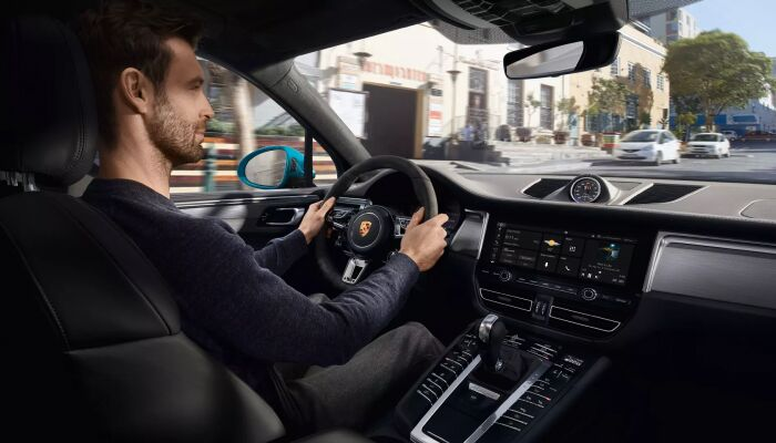 2019 Porsche Macan interior front cabin man in front seat driving vehicle