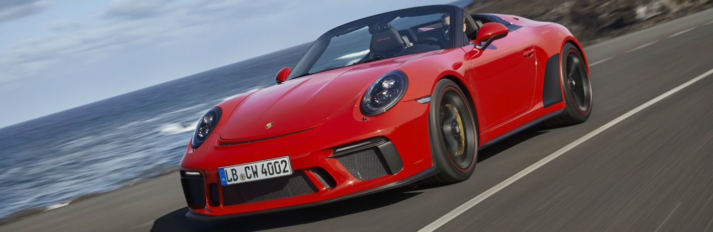 2019 Porsche 911 Speedster exterior front fascia and driver side going fast on beach highway