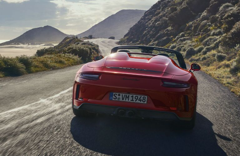 2019 Porsche 911 Speedster exterior back fascia going fast on mountain road