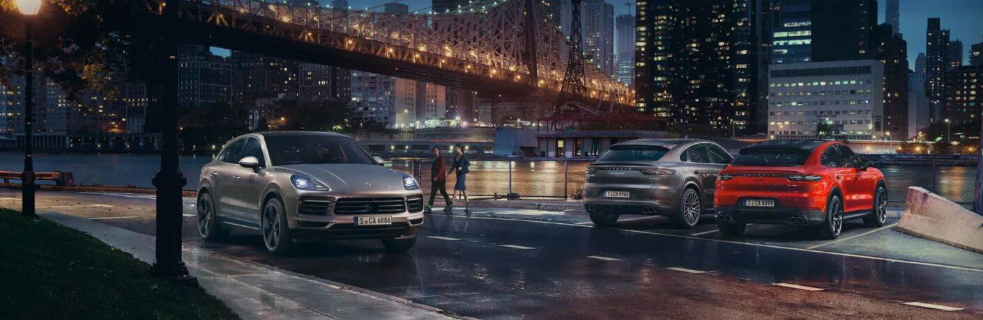 2019 Porsche Cayenne Coupe models in big city at night