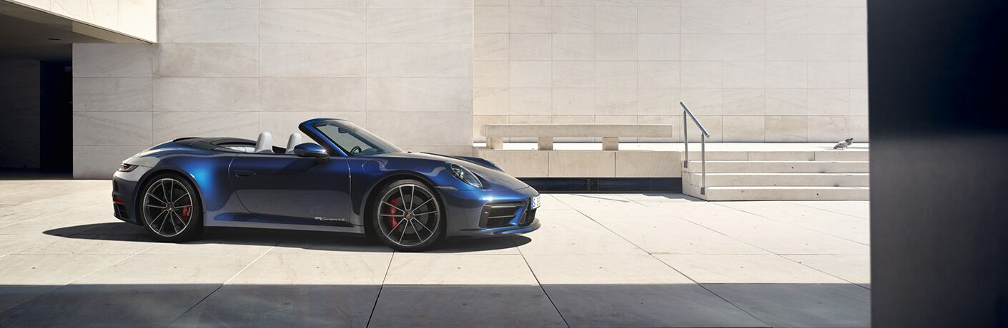 2020 Porsche 911 exterior passenger side profile with top down