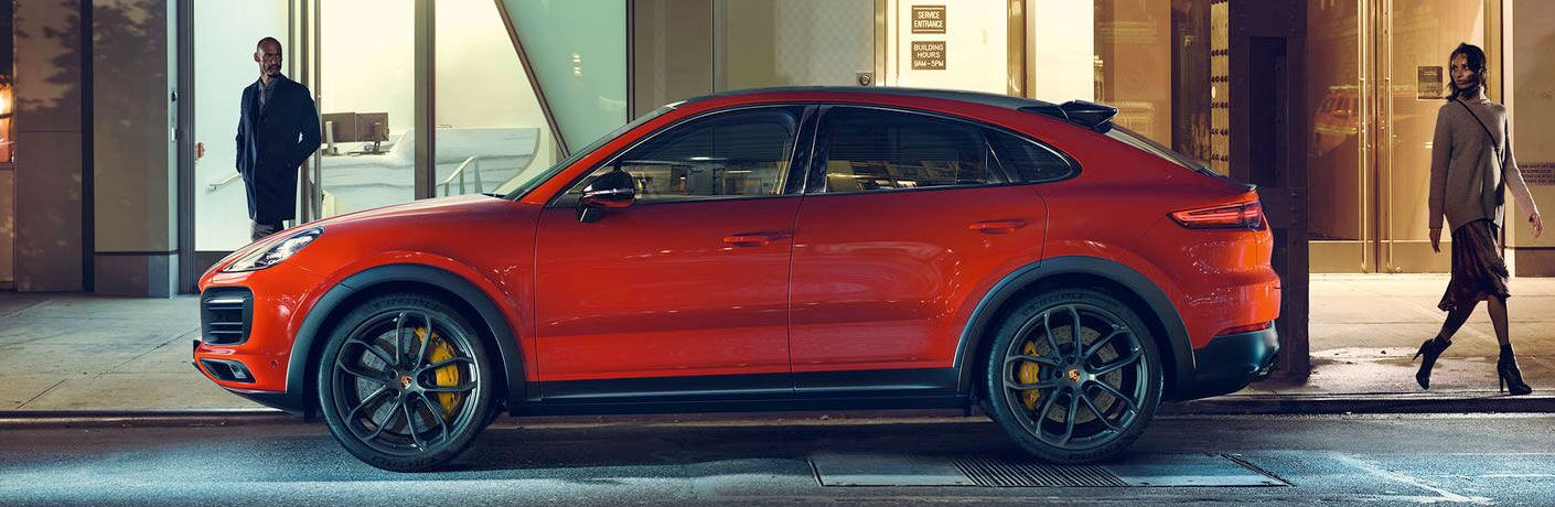 2020 Porsche Cayenne Coupe exterior drivers side parked on side of road with man near front of vehicle and woman near back