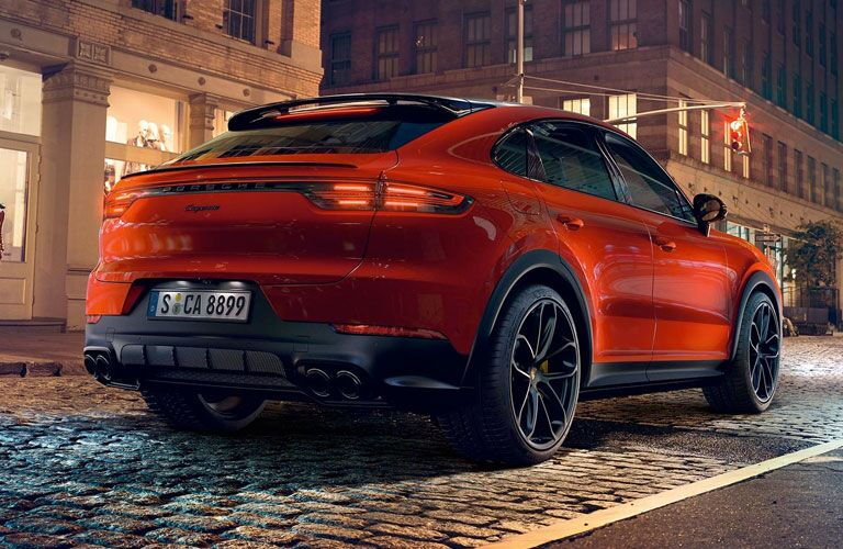 2020 Porsche Cayenne Coupe exterior back fascia and passenger side on brick road with stoplights