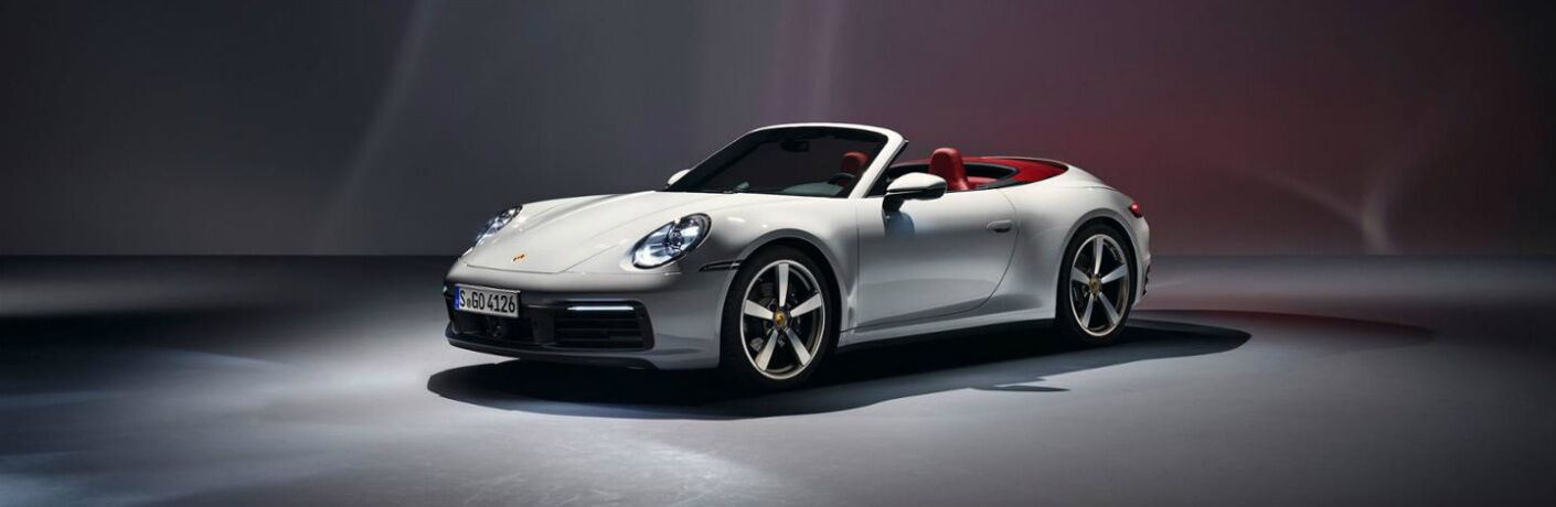 Side view of a white 2020 Porsche 911 Carrera Cabriolet