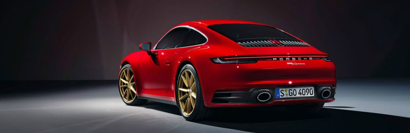 Rear side view of a red 2020 Porsche 911 Carrera Coupe
