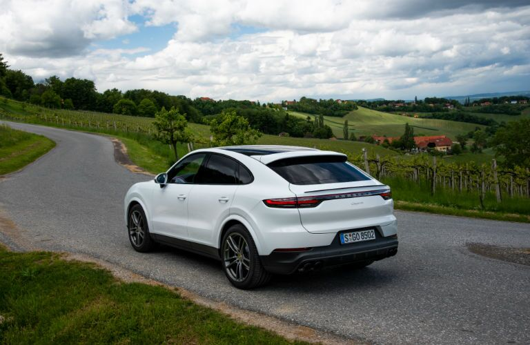 2020 Porsche Cayenne Coupe exterior back fascia and drivers side driving on country road