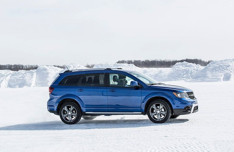 Blue 2017 Dodge Journey parked in the snow