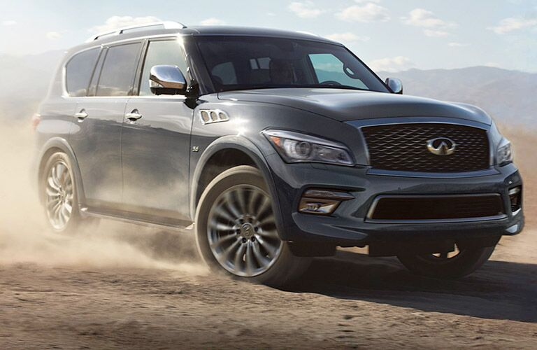 Grey 2017 INFINITI QX80 driving on desert terrain