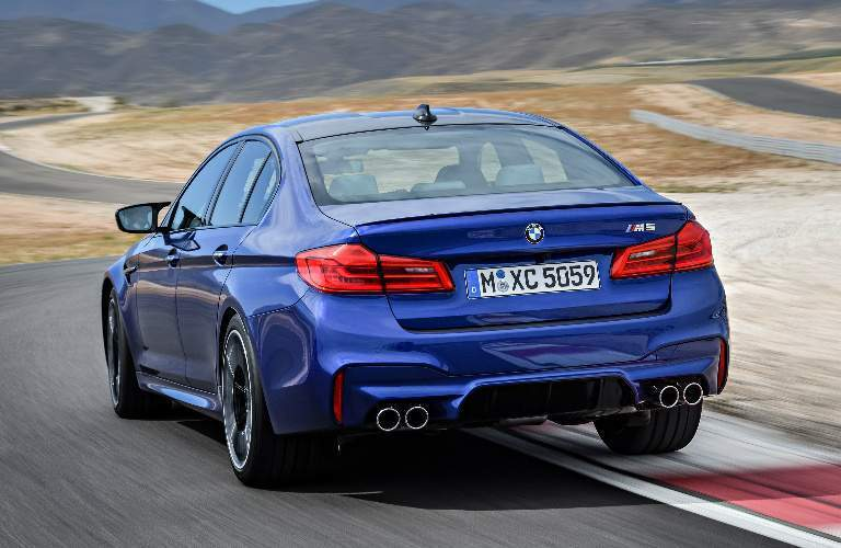 Blue 2018 BMW M5 Driving on a Race Track