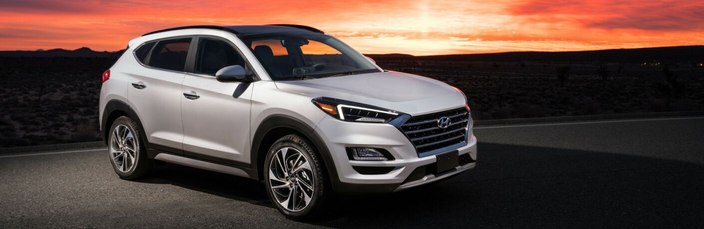 Silver 2019 Hyundai Tucson with a sunset in the background