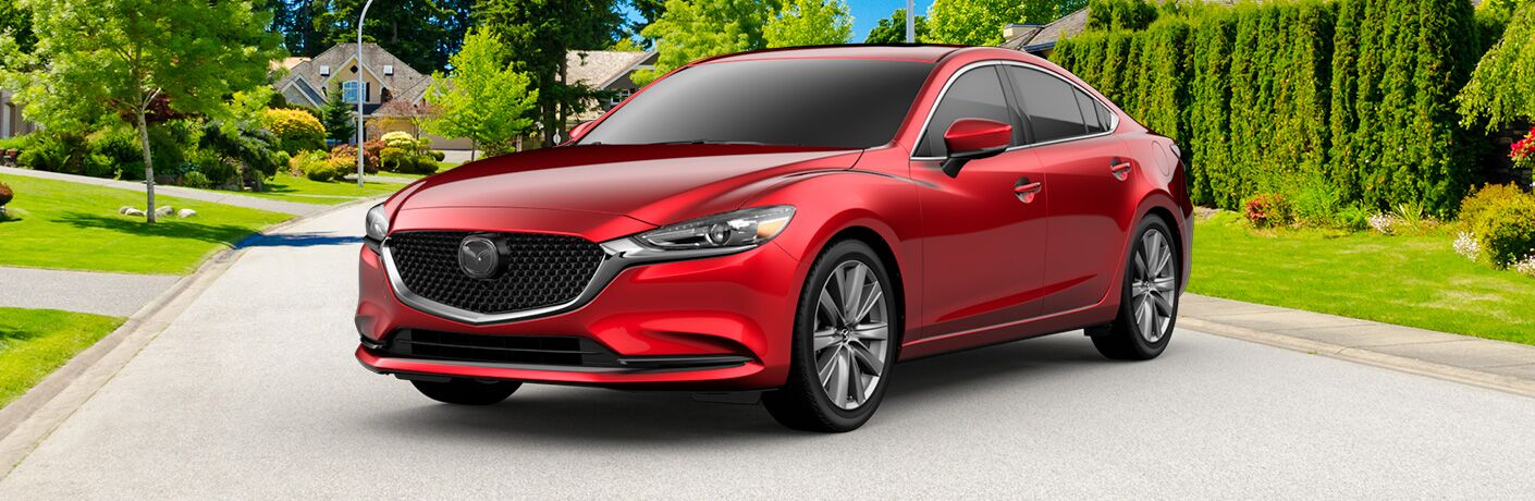 Red 2019 Mazda6 parked in the middle of a residential street