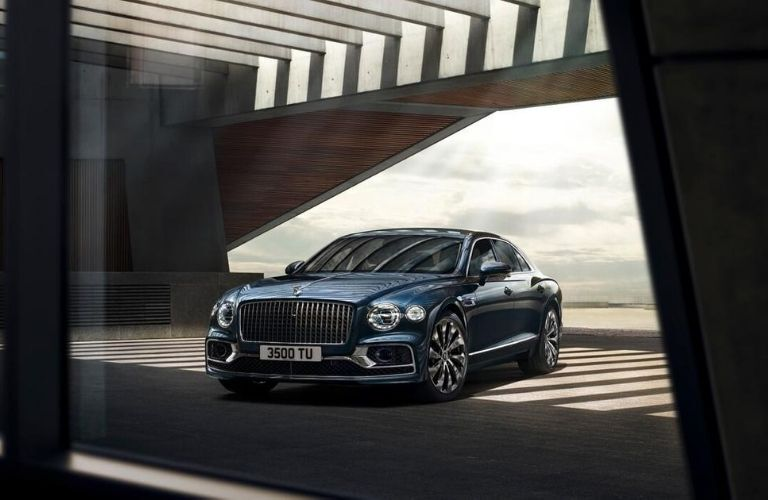 Exterior view of the front of a blue 2020 Bentley Flying Spur