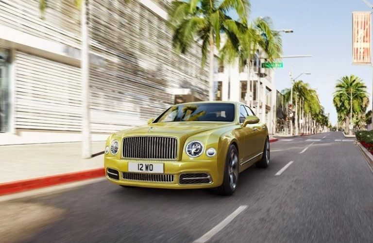 Exterior view of the front of a gold 2020 Bentley Mulsanne