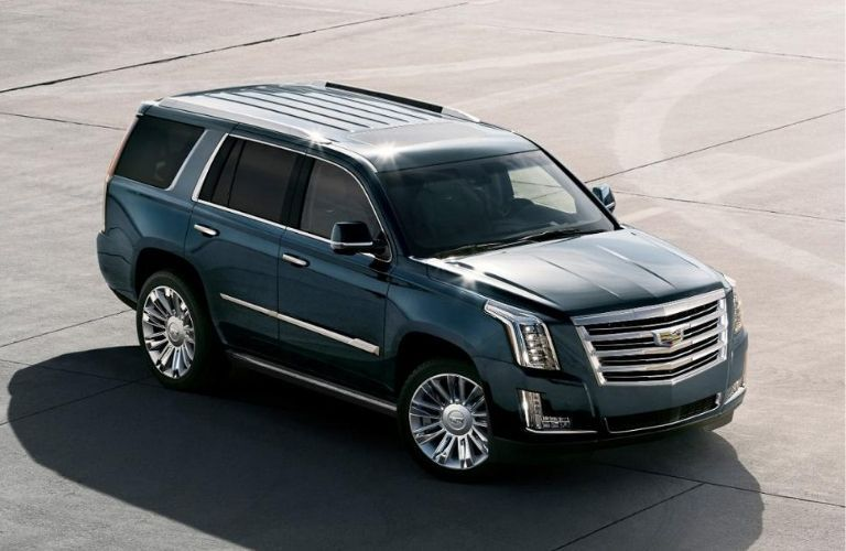 Exterior view of a teal 2020 Cadillac Escalade