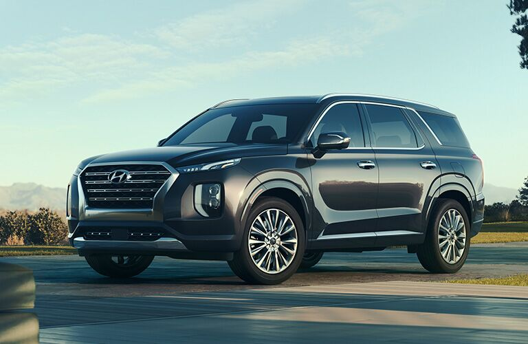 2020 Hyundai Palisade exterior shot with gray metallic paint color parked on an open plaza driveway