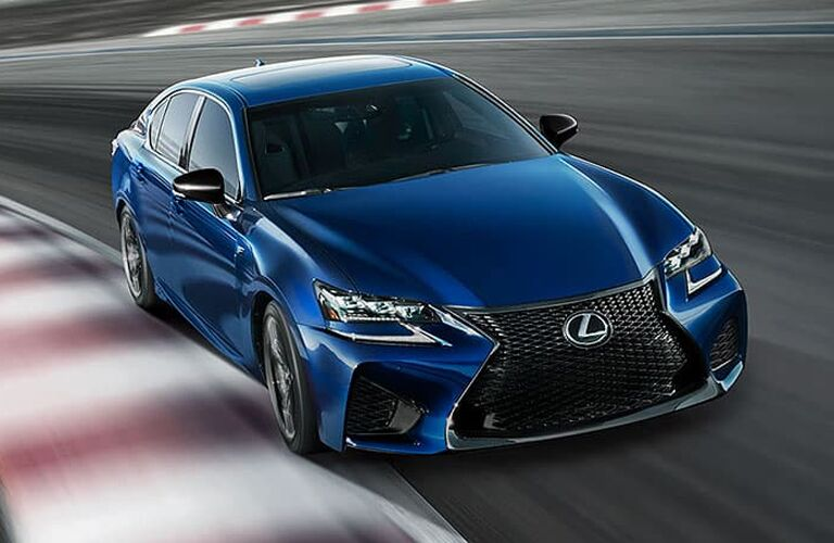 2020 Lexus GS F exterior shot with blue paint color driving on a race track