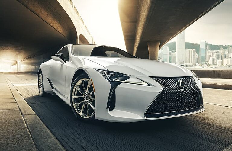 2020 Lexus LC exterior shot closeup of grille and headlights with white paint color parked under an overpass