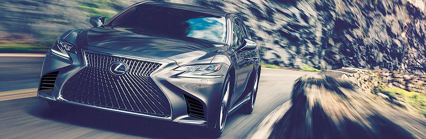 2020 Lexus LS exterior front shot closeup while racing down a cliffside highway