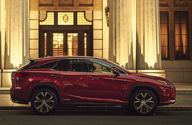 2020 Lexus RX Hybrid exterior shot with red paint color parked outside a marble building near stone columns