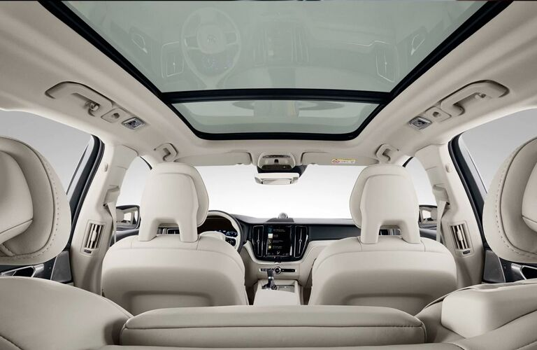 2020 Volvo XC60 interior shot from back seating show all seating row space, sunroof, and length of cabin