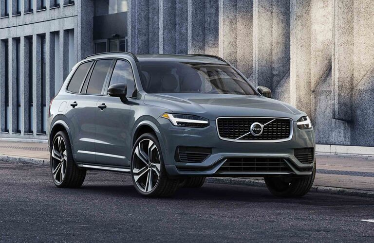 2020 Volvo XC90 exterior shot with gray paint color parked near concrete structures of walls and pillars