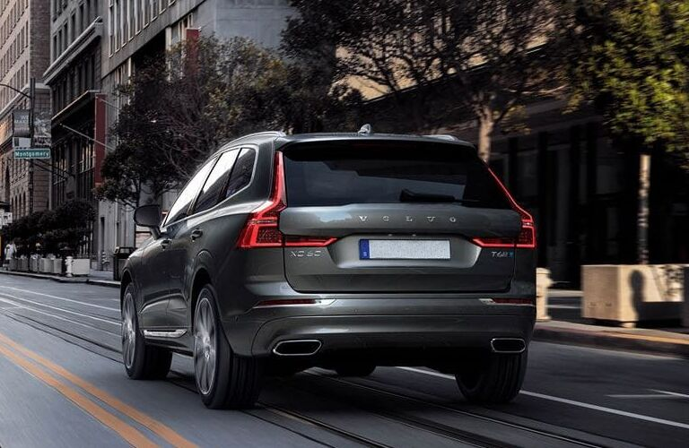 2020 Volvo XC60 exterior rear shot driving through a downtown city section