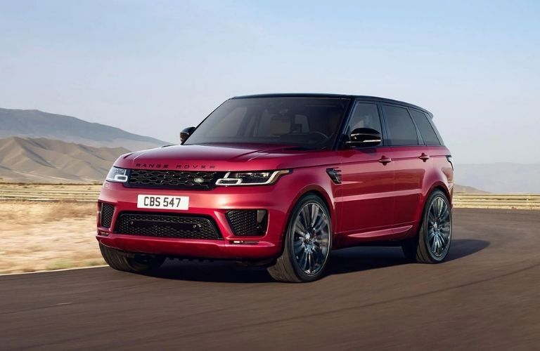 Exterior view of the front of a red 2021 Land Rover Range Rover Sport