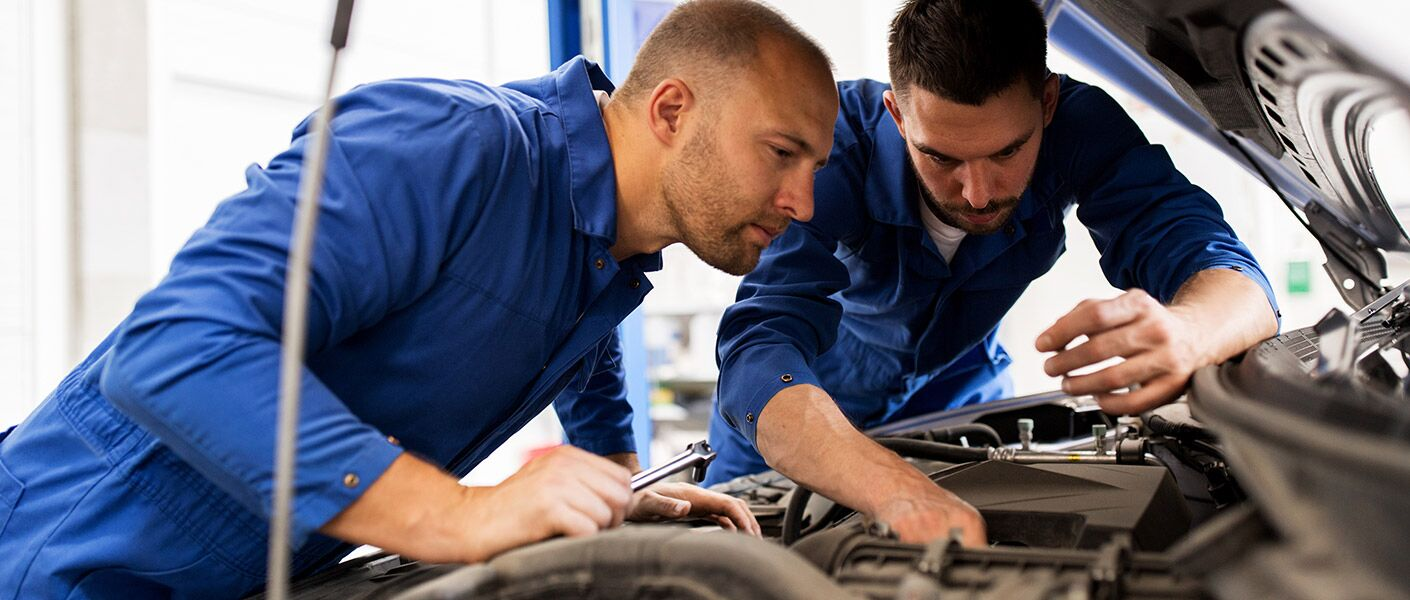 two men working on vehicle
