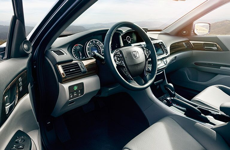 Interior cockpit view of the 2017 Honda Accord sedan. Showcasing driver's seat area and controls.