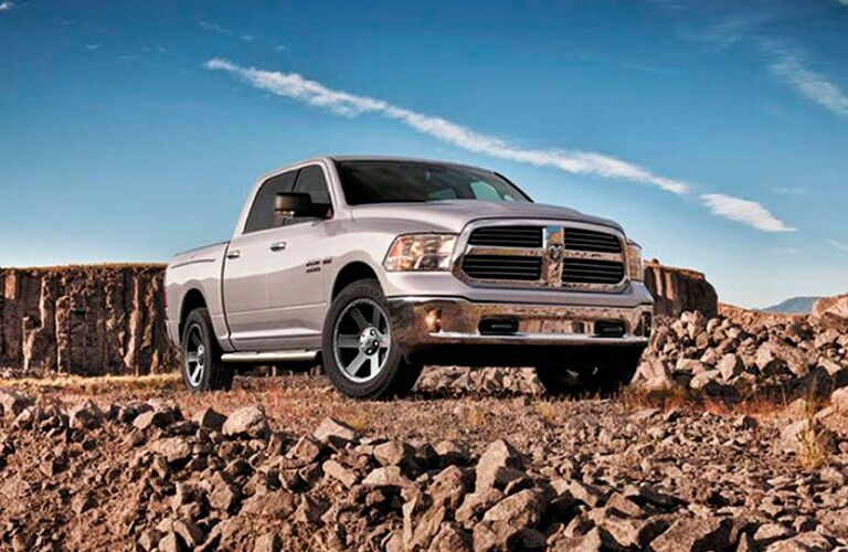 2017 Dodge Ram 1500 parked in a desert. Exterior side angled front view.