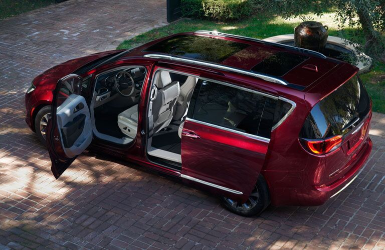 side view of a red Chrysler Pacifica with its doors open