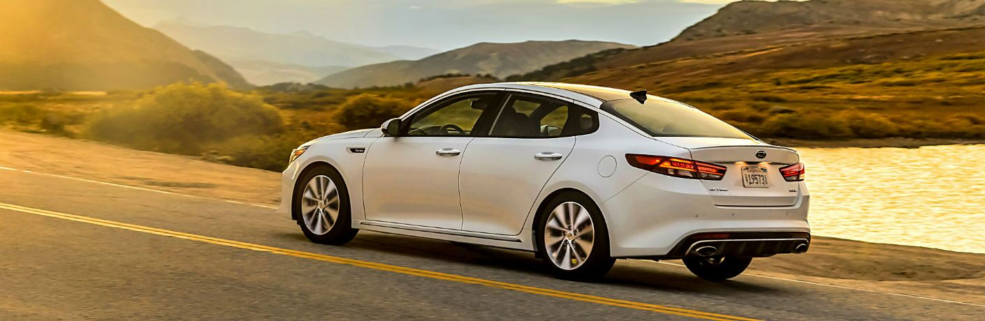 2018 Kia Optima driving in the country at sunset