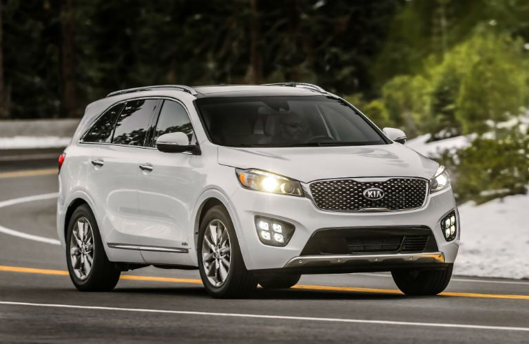 2018 Kia Sorento in white driving in the winter