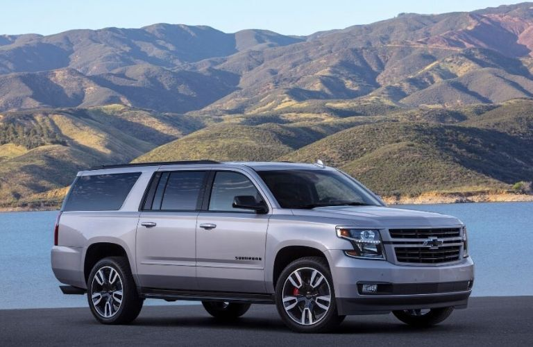 2020 Chevy Suburban from exterior front passenger side in front of water