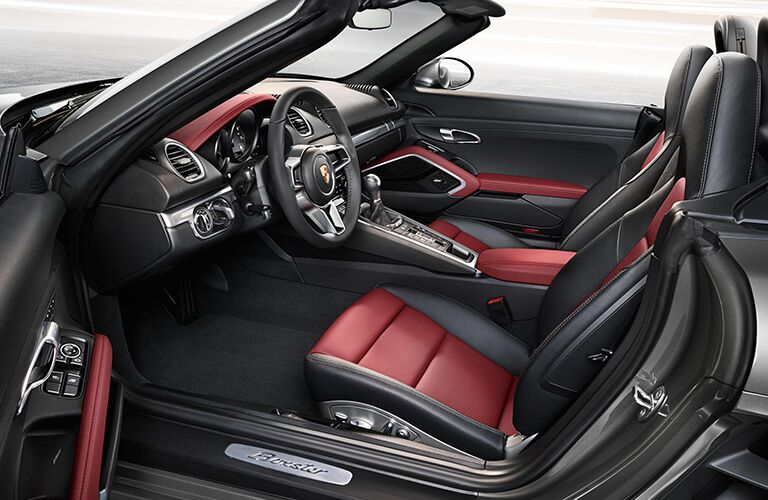 2019 Porsche 718 Boxster interior side shot with driver's door open showing seating upholstery material and design