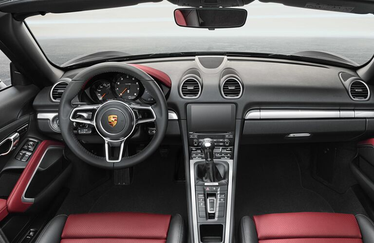 2019 Porsche 718 Boxster interior front shot of steering wheel, transmission, dashboard layout, and infotainment screen