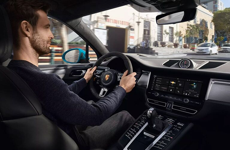 2020 Porsche Macan with man in driver's seat