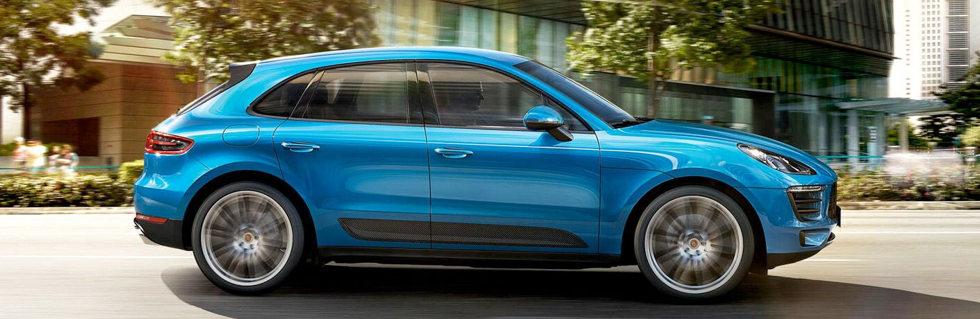 2019 Porsche Macan exterior passenger side profile on blurred road