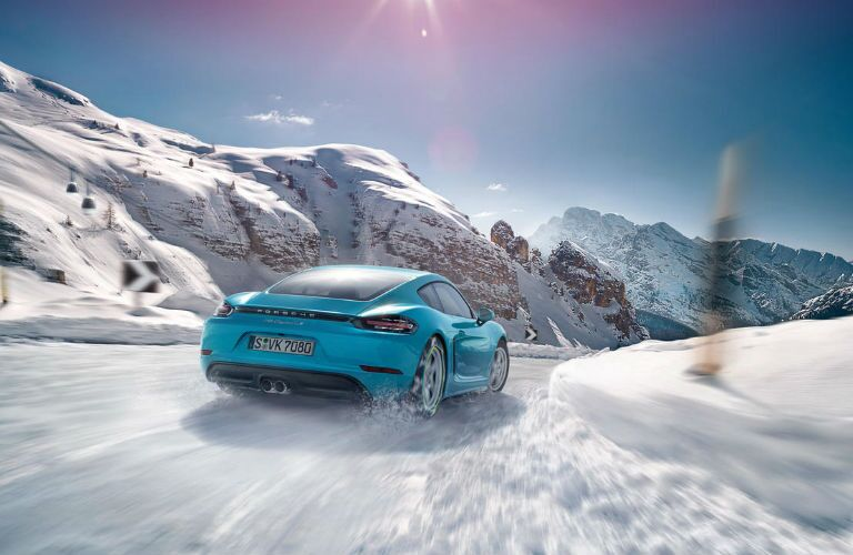 2018 Porsche 718 Cayman driving through snow