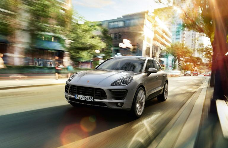 2018 Porsche Macan driving through a city
